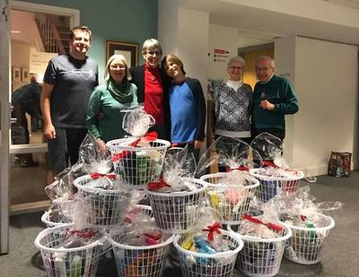 Volunteers put together holiday baskets for the HomeStart shelter